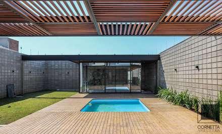 modern Pool by Cornetta Arquitetura