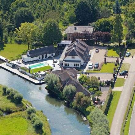 Landelijke woning met zwembad: landelijk Zwembad door Brand BBA I BBA Architecten