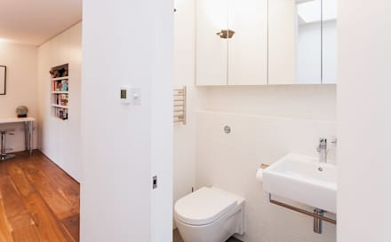 Extension & House Renovation SW18 - London: modern Bathroom by Diamond Constructions Ltd