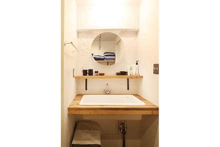 舟入本町の家: SWITCH&Co.が手掛けたお風呂です。