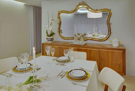 Pormenor de decoração sala de jantar: Salas de jantar modernas por B.loft