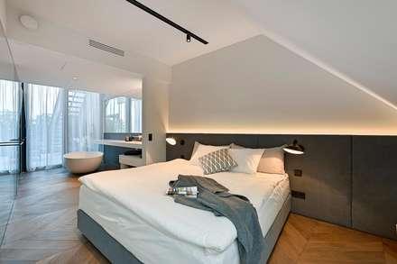 Attico G 43/13: Camera da letto in stile in stile Moderno di FADD Architects