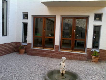 Tuscan House Renovations: rustic Garden by SOJE Interior, Design and Decor PTY (Ltd)