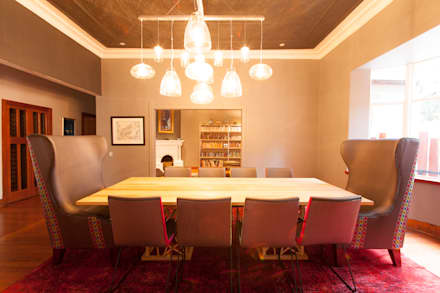 House B Jozi: eclectic Dining room by Redesign Interiors