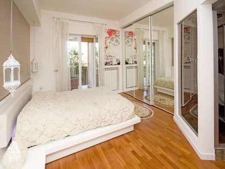 Ristrutturazione appartamento 130 mq: Camera da letto in stile in stile Eclettico di Fabiola Ferrarello architetto