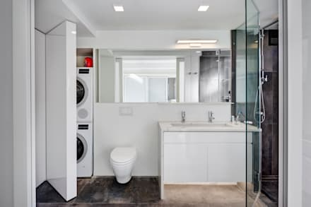 Master Bathroom with Laundry Closet: modern Bathroom by Lilian H. Weinreich Architects