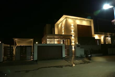North elevation-Night view: modern Houses by Hasta architects