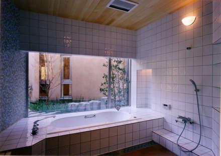 バスルーム: 豊田空間デザイン室 一級建築士事務所が手掛けたスパです。