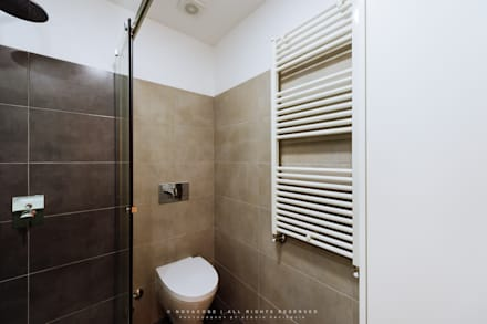 Casa de banho do quarto principal: Casas de banho modernas por NOVACOBE - Construção e Reabilitação, Lda.