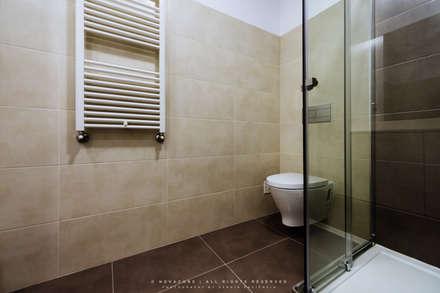 Casa de banho: Casas de banho modernas por NOVACOBE - Construção e Reabilitação, Lda.