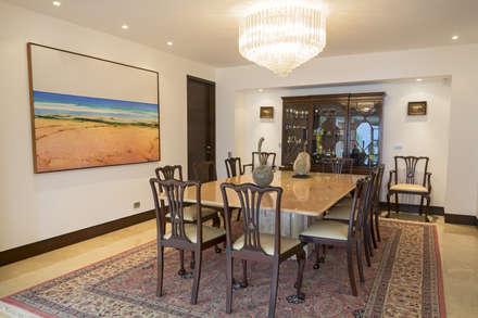 Casa 906: Comedores de estilo moderno por Objetos DAC
