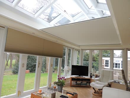 Watch Wimbledon even in the brightest summer sunshine!: modern Conservatory by Premier Blinds, Shutters & Awnings