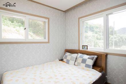 정갈하고 깔끔한 고급스러운 전원주택: 꿈애하우징의  침실