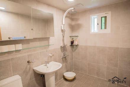 정갈하고 깔끔한 고급스러운 전원주택: 꿈애하우징의  화장실
