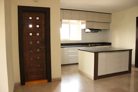 Mr. RadhaKrishna Flat Interiors: modern Kitchen by Vidhitsa Group- Architects, Interior Designers & Landscape Designers