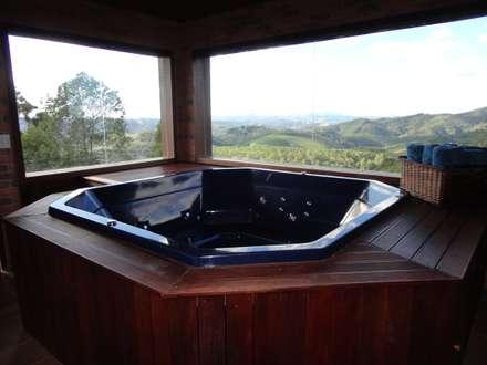 Spa de estilo rural por Repsold Projetos e Design