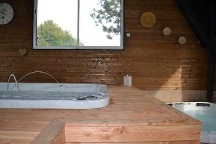 Aménagement d'espace : Réalisation d'un espace bien-être: Spa de style de stile Rural par KREA Koncept