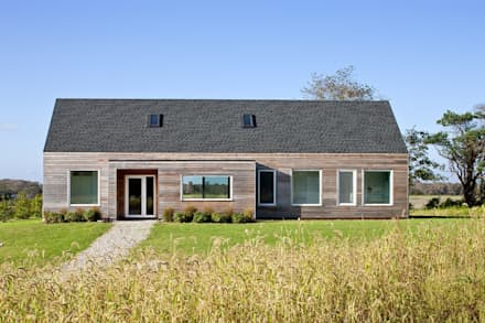 Passive House Retreat, south elevation: modern Houses by ZeroEnergy Design
