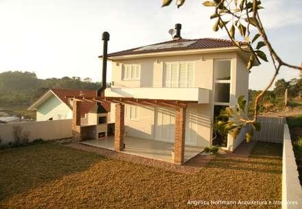 Ponte Seca: Casas modernas por Angelica Hoffmann Arquitetura e Interiores
