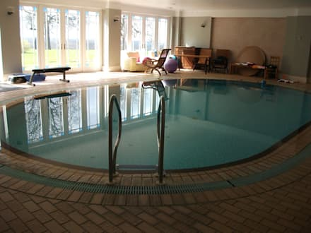 BEFORE REFURBISHMENT: modern Pool by Tanby Swimming Pools