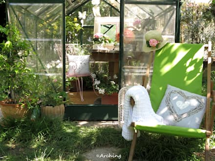 Una piccola serra tutta al femminile: Giardino d'inverno in stile In stile Country di Arching - Architettura d'interni & home staging