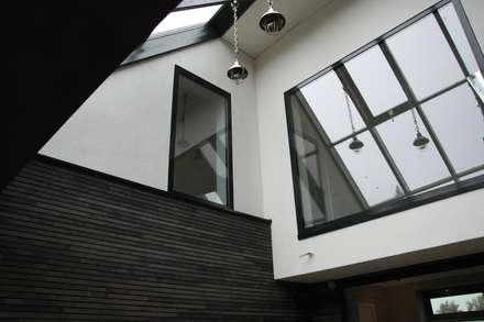 Modern Landhuis: moderne Serre door Architectenbureau Jules Zwijsen
