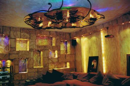 Кинозал на цокольном этаже частного дома: Винные погребы в . Автор – Строев Михаил