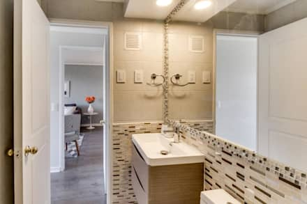 Baños totalmente modernizados: Baños de estilo moderno por Studio Barla