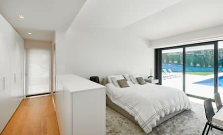 Dormitorio: Dormitorios de estilo moderno de DECONS  GKAO S.L.