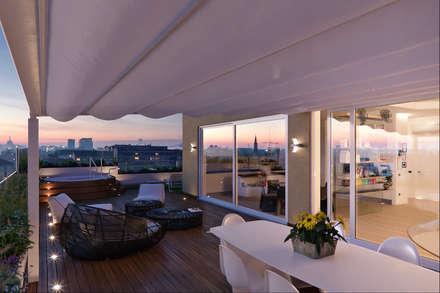 Un attico in stile loft in Milano: Terrazza in stile  di Annalisa Carli