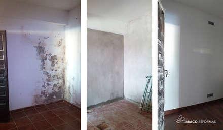 Reparación de humedades en trastero (sótano), mediante impermeabilización por cara interior: Garajes de estilo rústico de ÁBACO REFORMAS