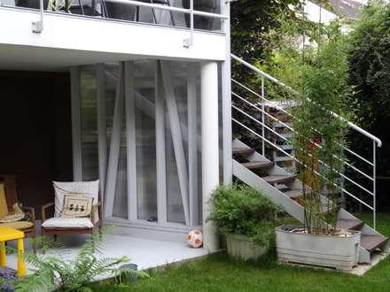 Maison à Antony: Jardin d'hiver de style  par ATO ARCHITECTURE