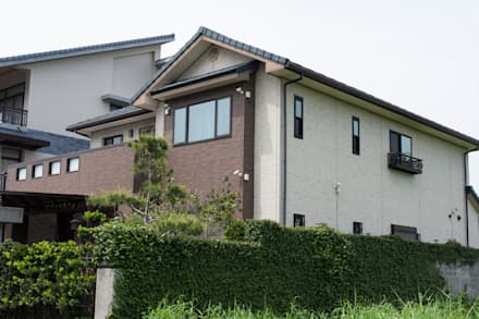 Casas de estilo asiático por 台日國際住宅股份有限公司