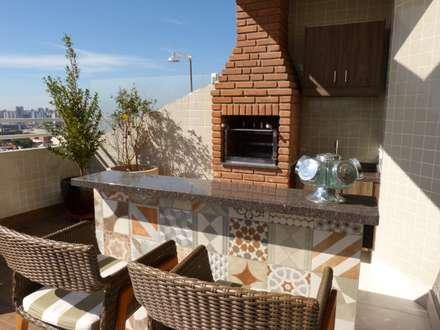 Varanda Gourmet: Terraços  por Palladino Arquitetura