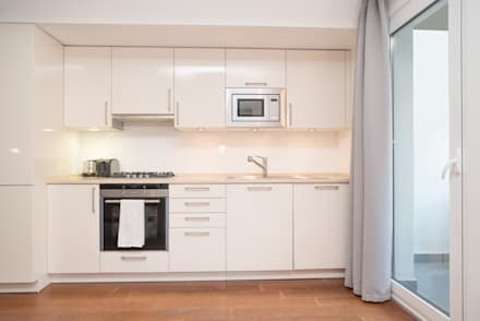 Apartamento com vista para Lisboa: Cozinhas modernas por Margarida Bugarim Interiores