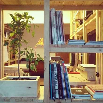 Biblioteca_Oficinas Taller Independiente Arquitectura & Construccion: Estudios y biblioteca de estilo  por Taller Independiente - Arquitectura & Diseño