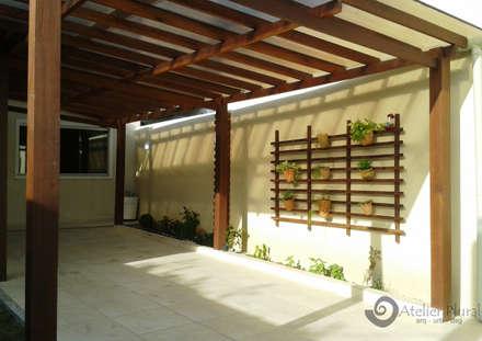 Garages de estilo rústico por Atelier Plural