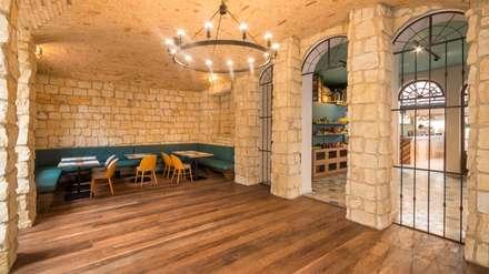 Salón Cartagena: Locales gastronómicos de estilo  por KDF Arquitectura