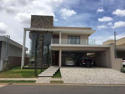 Casa C+W: Casas modernas por Arquitetando e Inspirando