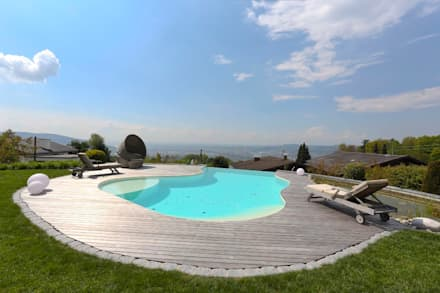 Baden auf höchster Stufe: moderner Pool von freiraum* Gartenarchitektur GmbH