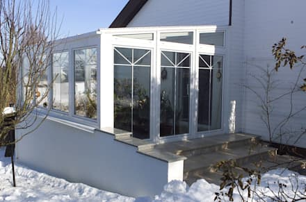 Jardines de invierno de estilo clásico de Schmidinger Wintergärten, Fenster & Verglasungen