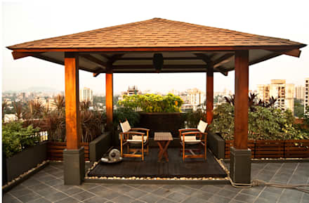 Covered sitting area: modern Garden by Land Design landscape architects