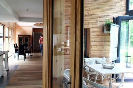 j'ardin d'hiver: Jardin d'hiver de style  par yg-architecte