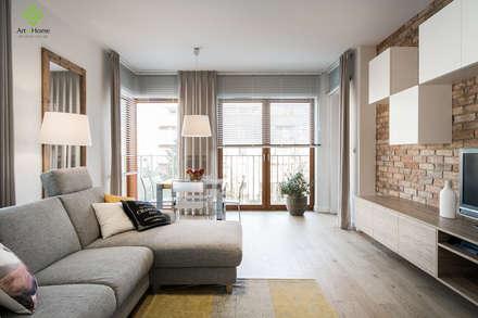 .rodzinne mieszkanie w Warszawie: styl , w kategorii Salon zaprojektowany przez Art of home