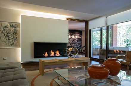 living: Livings de estilo ecléctico por Thomas Löwenstein arquitecto