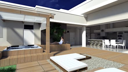 Residência Abrolhos: Jardins clássicos por PACKER arquitetura e engenharia