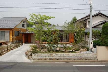 Casas de estilo asiático por 田村建築設計工房