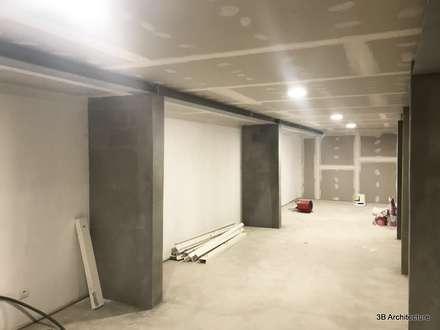 Garage: Garage / Hangar de style de style Moderne par 3B Architecture