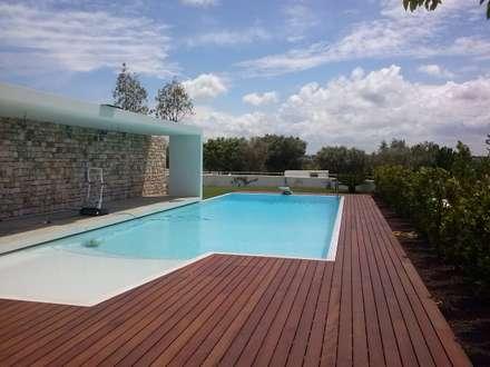 casa  Todisco: Piscina in stile in stile Moderno di BRUSCHI.ESPOSITO STUDIO DI ARCHITETTURA