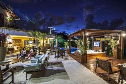 Home Resort: Jardins ecléticos por Amanda Diniz Arquitetura & Interiores